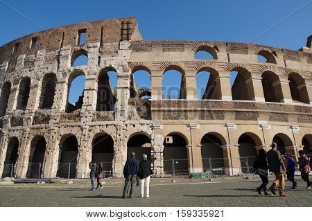 ROME, ITALY - JUNE 19: Many tourists visiting The Colosseum or Coliseum, also known as the Flavian Amphitheatre in Rome, Italy on June 19, 2015.