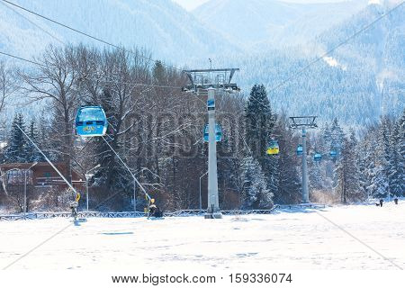 Bansko, Bulgaria - November 30, 2016: Bansko ski resort panorama with cable car ski lift cabin and snow mountains