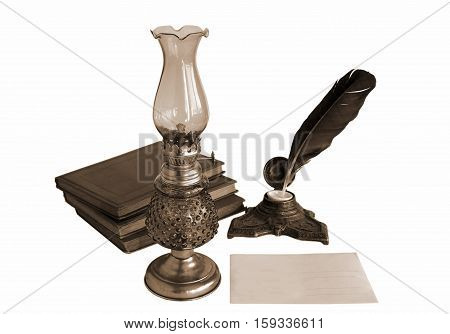 Blank paper card oil lamp and inkwell with quill pen as a concept of writing letters and greetings on holidays. Photo in sepia tone