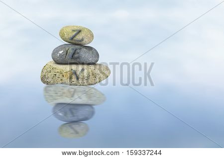 View of pebbles balancing on each other on diffused backgrounds