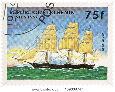 MOSCOW RUSSIA - NOVEMBER 30 2016: A stamp printed in Benin shows american sailing ship (Clipper)