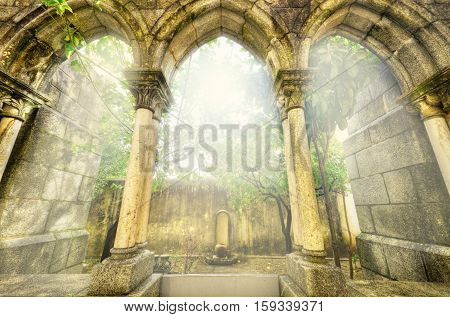 Ancient gothic arches in the myst. Fantasy landscape in Evora Portugal.