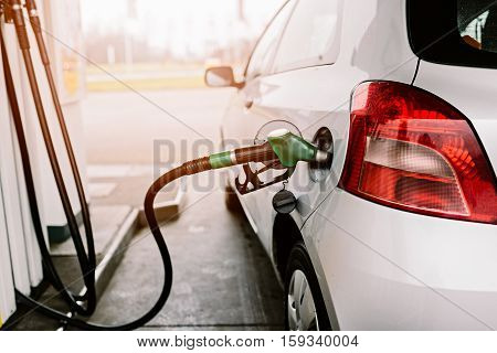 Silver Car Refuelling At The Gas Station