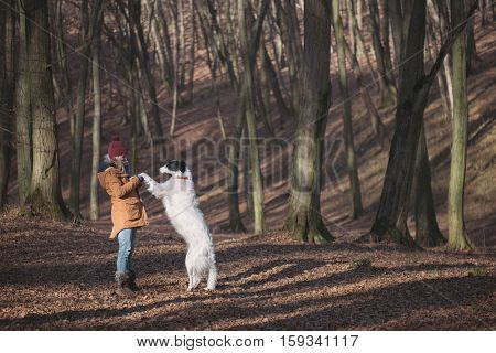 Woman playing with dog outdoor