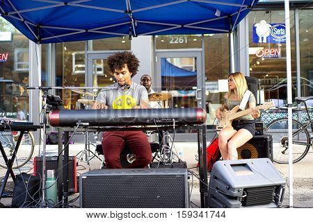 TORONTO, CANADA - AUGUST 22, 2015; Street perfomer during Toronto Jazz festival on Queen street east.