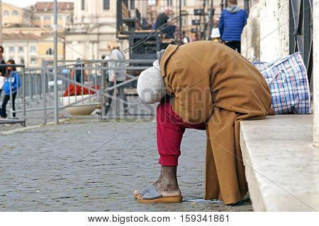 Homeless people, like pictured ones, can be seen almost on every corner of every street in the center of all the big cities