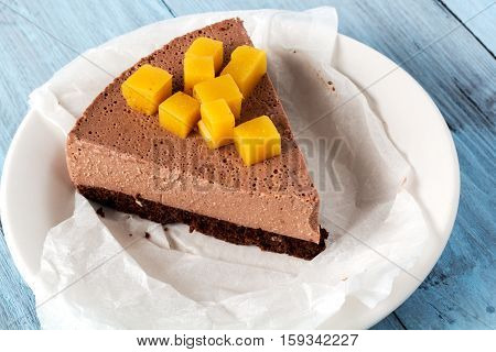 cut piece cheesecake cheese chocolate on blue boards