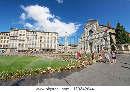 FLORENCE ITALY - AUGUST 17: Tourist visiting famous Basillica Santa Maria Novella on August 17 2013 in Florence Italy.