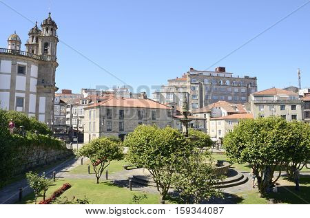 PONTEVEDRA, SPAIN - AUGUST 6, 2016: Church of the Pilgrim Mother adn other buildings in plaza in the city of Pontevedra Galicia Spain.