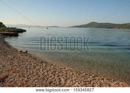 Beautiful Croatian beach  with clear crystal water.