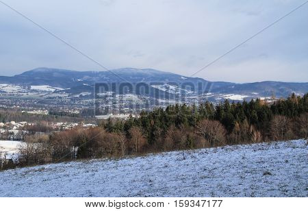 Landscape of Beskydy mountains in winter on cloudy day