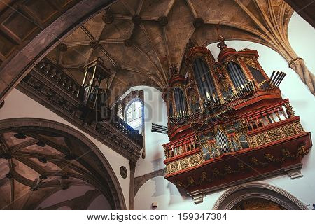 COIMBRA, PORTUGAL - September 26, 2013: The baroque organ in the Santa Cruz Monastery, Monastery of the Holy Cross, is a National Monument in Coimbra, Portugal