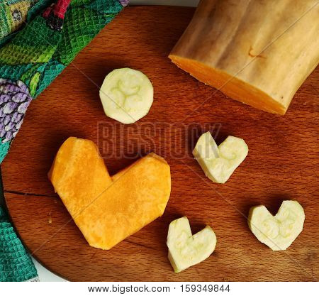 cut pumpkin and courgette in heart form image as food stylish decoration to valentines day dinner
