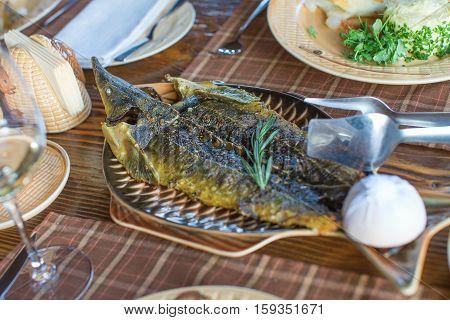 Fried Sturgeon Served On A Plate