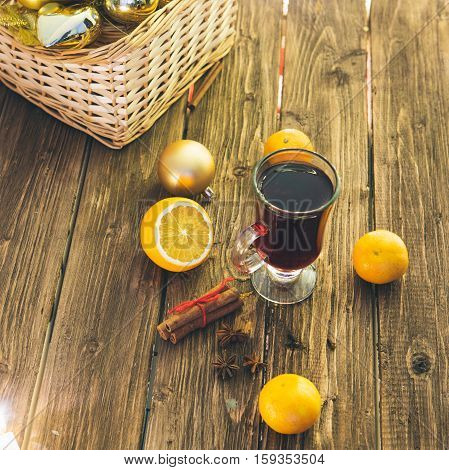Christmas Mulled Wine On A Rustic Wooden Table.