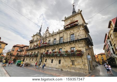 LEON SPAIN - AUGUST 22: Tourist visiting Leon council building on a rainy day on August 22 2016 in Leon Spain.
