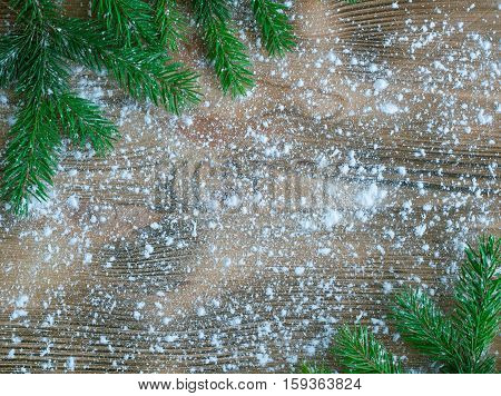 Christmas Tree Green Branches On Winter Snowbound Wooden Space Background