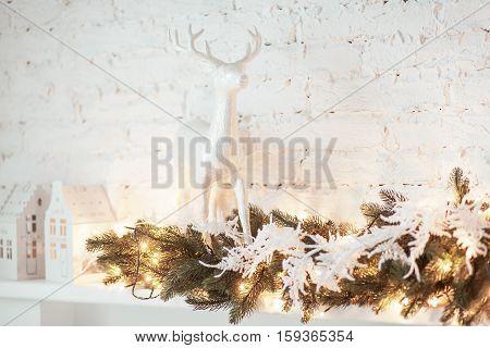 Burning lantern and christmas decoration on white background. Xmas tree. Candleholder house.