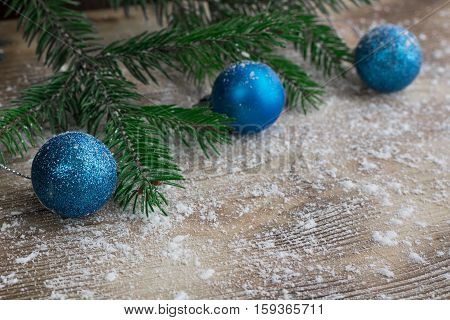 Christmas Tree Branches, Blue Balls On Winter Snowbound Wooden Background