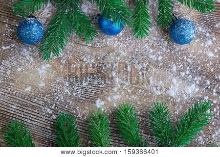 Christmas Tree Branches, Blue Balls On Winter Snow Wooden Background