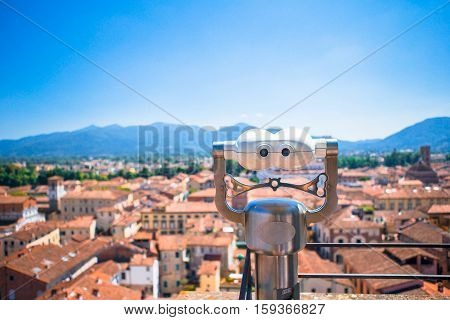 Telescope with coin on an observation deck of small city