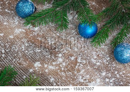 Christmas Tree Branches, Blue Balls On Snowbound Winter Wooden Background
