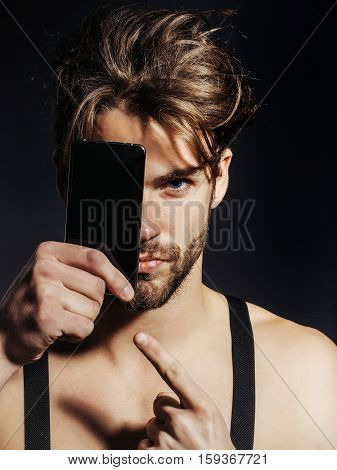Handsome Man Points At Smartphone