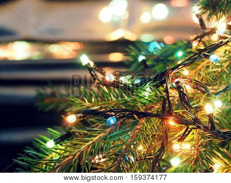 Christmas lights on Christmas tree decorative garland on blurred background brilliant