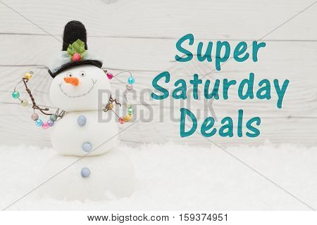 Super Saturday message Some snow and a snowman on weathered wood with text Super Saturday Deals