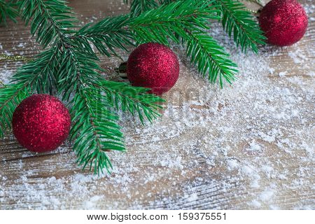 Christmas Tree Branches, Red Balls On Winter Snowbound Wooden Background