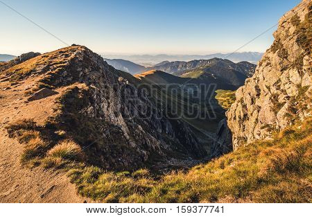 Mountain Landscape in Light of Setting Sun. View from Mount Dumbier in Low Tatras Slovakia. West Tatras Mountains Background.