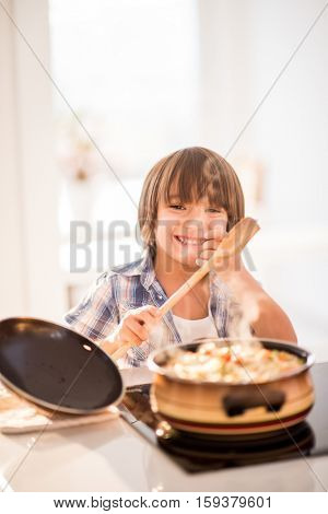 Cute adorable little boy in the kitchen
