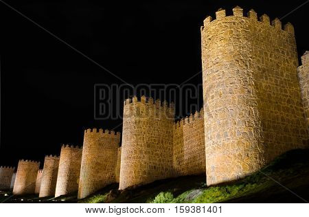 Avila at night medieval city walls. Castile and Leon Spain.