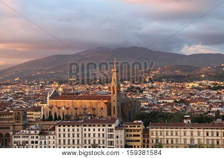 Florence Italy - November 04 2013: view of the Santa Croce Church at sunset on November 2013 in Florence Tuscany Italy.