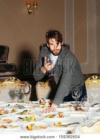 Handsome Man Eats After Banquet