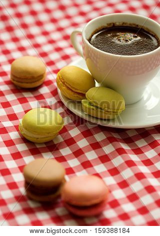 Cup Of Coffee With Traditional French Macaroon Cookies