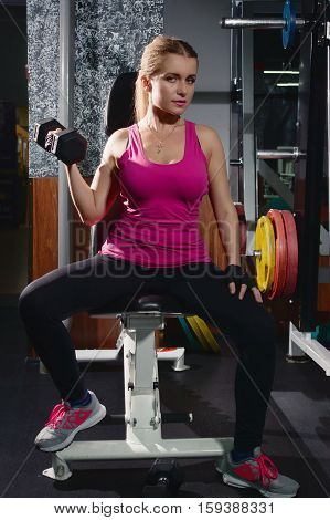 Fiit Girl Doing Exercises With Dumbells In Gym