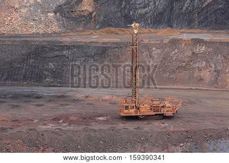 Blast hole drill at work in Tom Price iron ore mine
