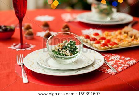 Decorated Christmas Dining Table With Delicious Salad (spinach, Pear, Blue Cheese And Pine Tree Nuts