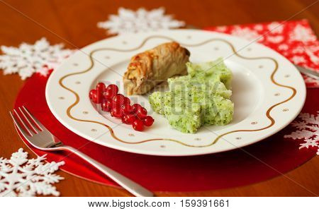 Decorated Christmas Dining Table With Tasty Veal And Mashed Potatoes With Broccoli In Form Of A Chri