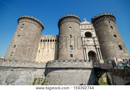 NAPLES ITALY - AUGUST 19: Tourist visiting Castle Nouvo on August 19 2013 in Naples Italy.