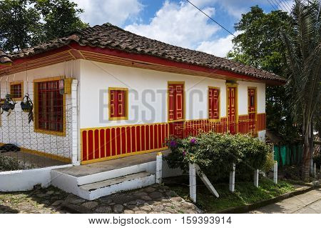 View of a traditional colonial house painted in bright colors in the town of Salento in Colombia South America; Concept for traveling in South America and Colombia