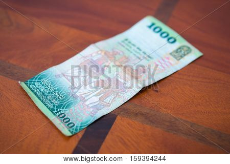 One Thousand Rupees.