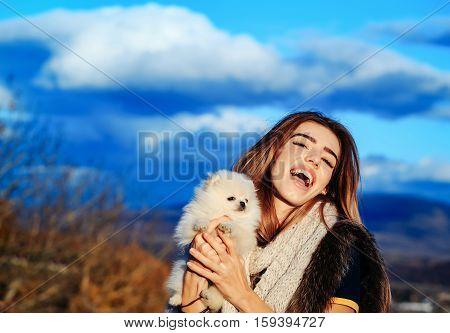 Happy Girl Holds Cute Dog