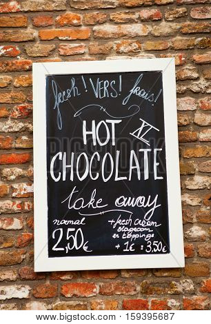 Menu With Hot Chocolate Price On The Wall