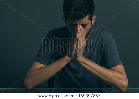 Sad Man Sitting In Dark Room. Depression And Anxiety Disorder Concept