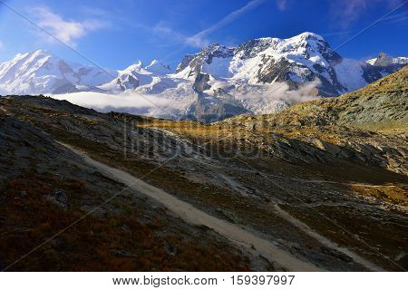 The hiker are walking from Rotenboden station to Riffelsee lake and Matterhorn in summer Zermatt Switzerland