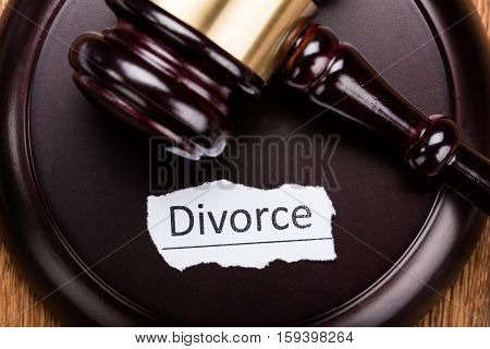 Close-up Of Divorce Concept On Wooden Mallet In Courtroom