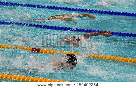 Hong Kong China - Oct 29 2016. SAVARD Katerine (CAN) Katinka HOSSZU (HUN) and WORRELL Kelsi (USA) swimming in the Women's Butterfly 100m Final. FINA Swimming World Cup Victoria Park Swimming Pool.