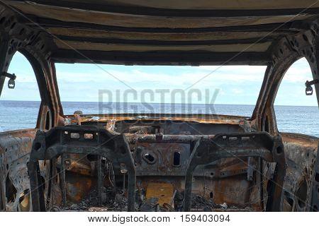 burned down car wreck - damaged car